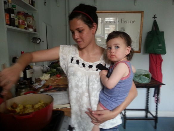 Kleine and mommy cooking curry